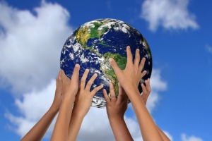 Children Holding Earth in Their Hands